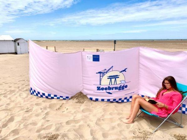 Bedrukte strandschermen strandzeil